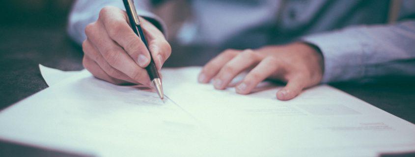 man hand writing notes image